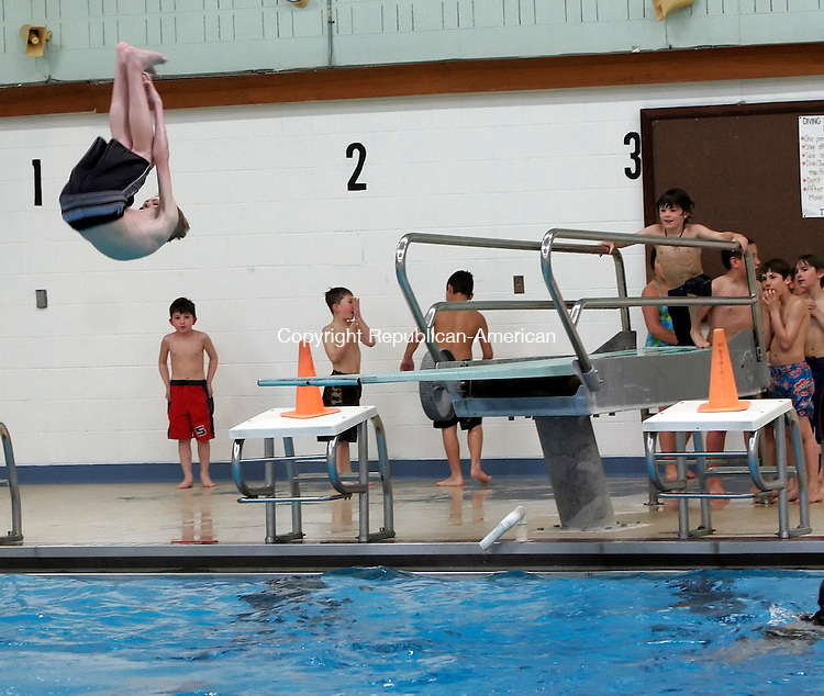 WATERTOWN, CT-18 April 2006-041806TK04- Ian Birtwistle leaps off the diving board at  the Watertown School's Frank M. Reinhold Pool as part of the holiday week vacation activities, The Watertown Recreation Department sponsored a free splash pool party.   Tom Kabelka Republican-American (Ian Birtwistle)