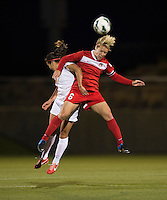 Veronica Perez (17) of the Western NY Flash goes up for a header with Lori Lindsey (6) of the Washington Spirit during the game at the Maryland SoccerPlex in Boyds, MD.  Washington tied Western NY, 1-1.