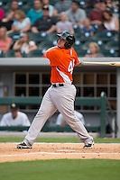 Steve Clevenger (45) of the Norfolk Tides follows through on his swing against the Charlotte Knights at BB&T BallPark on April 9, 2015 in Charlotte, North Carolina.  The Knights defeated the Tides 6-3.   (Brian Westerholt/Four Seam Images)