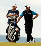 Graeme McDowell and his caddy Ken Comboy take a long hard look at what to play into the 18th greenduring the Barclays Scottish Open, played over the links at Castle Stuart, Inverness, Scotland from 7th to 10th July 2011:  Picture Stuart Adams /www.golffile.ie 7th July 2011