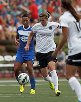 Portland Thorns FC forward Christine Sinclair (12) on the attack.  In a National Women's Soccer League (NWSL) match, Portland Thorns FC (white) defeated Boston Breakers (blue), 2-1, at Dilboy Stadium on July 21, 2013.