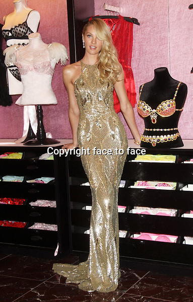NEW YORK, NY - NOVEMBER 6: Candice Swanepoel show off the new Victoria's Secret Royal Fantasy Bra at the Victoria's Secret store at Herald Square in New York City. November 6, 2013.<br /> Credit: MediaPunch/face to face<br /> - Germany, Austria, Switzerland, Eastern Europe, Australia, UK, USA, Taiwan, Singapore, China, Malaysia, Thailand, Sweden, Estonia, Latvia and Lithuania rights only -