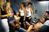 Russians drink Champagne on their chartered flight home from Antalya on Turkey's Mediterranean coast. Russia's new wealth is allowing its citizens to travel to places they once could not.