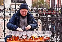 Street performer playing music on glasses, Madrid, Spain.