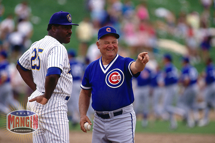 CHANDLER, AZ - Don Baylor of the Milwaukee Brewers talks to manager Don Zimmer of the Chicago Cubs before a spring training game at Compadre Stadium in Chandler, Ariona in 1991. (Photo by Brad Mangin)