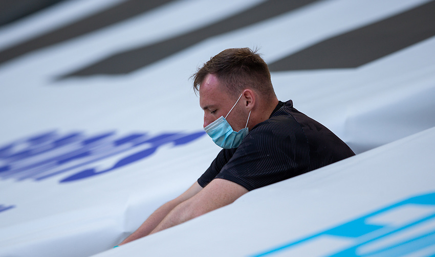 A member of the Newcastle United cleaning team in thought<br /> <br /> Photographer Alex Dodd/CameraSport<br /> <br /> The Premier League - Newcastle United v Aston Villa - Wednesday 24th June 2020 - St James' Park - Newcastle <br /> <br /> World Copyright © 2020 CameraSport. All rights reserved. 43 Linden Ave. Countesthorpe. Leicester. England. LE8 5PG - Tel: +44 (0) 116 277 4147 - admin@camerasport.com - www.camerasport.com