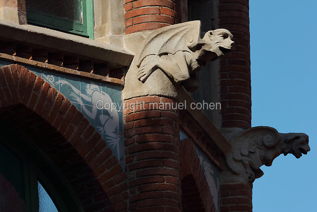 Sculptural detail of 2 gargoyles as winged monsters, symbols of illness and death, at the Hospital de Sant Pau, or Hospital de la Santa Creu i Sant Pau, built 1902-30, designed by Catalan Modernist architect Lluis Domenech i Montaner, 1850-1923, in El Guinardo, Barcelona, Catalonia, Spain. The original medieval hospital of 1401 was replaced with this complex in the 20th century thanks to capital provided in the will of Pau Gil. The hospital consists of 27 pavilions surrounded by gardens and linked by tunnels, using the Modernist Art Nouveau style with great attention to detail. On the death of the architect, his son Pere Domenech i Roura took over the project. The complex was listed in 1997 as a UNESCO World Heritage Site. Picture by Manuel Cohen