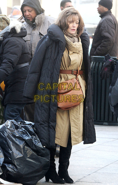 "MICHELLE PFEIFFER.Actress Michelle Pfeiffer films ""New Years Eve"" on location on the Streets of Manhattan, New York, NY, USA..February 23rd, 2011.on the set of behind the scenes act acting full length beige trenchcoat trench coat belt satchel black bag brown brunette hair .CAP/ADM/AC.©Alex Cole/AdMedia/Capital Pictures."