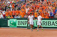 15-09-12, Netherlands, Amsterdam, Tennis, Daviscup Netherlands-Suisse, Doubles, Robin Haase/Jean-Julian Rojer   in front of Dutch supporters.