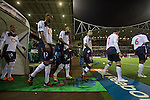 Bolton Wanderers 3 Liverpool 1, 21/01/2012. Reebok Stadium, Premier League. The home players taking to the pitch at the Reebok Stadium, before Bolton Wanderers take on Liverpool in a Barclays Premier League game. The match was won by Bolton by 3 goals to 1, watched by a near-capacity crowd of 26,854. The win lifted Bolton out of the relegation places in England's top division, while Liverpool remained seventh. Photo by Colin McPherson.