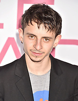 WESTWOOD, CA - MARCH 07: Moises Arias attends the Premiere Of Lionsgate's 'Five Feet Apart' at Fox Bruin Theatre on March 07, 2019 in Los Angeles, California.<br /> CAP/ROT/TM<br /> &copy;TM/ROT/Capital Pictures