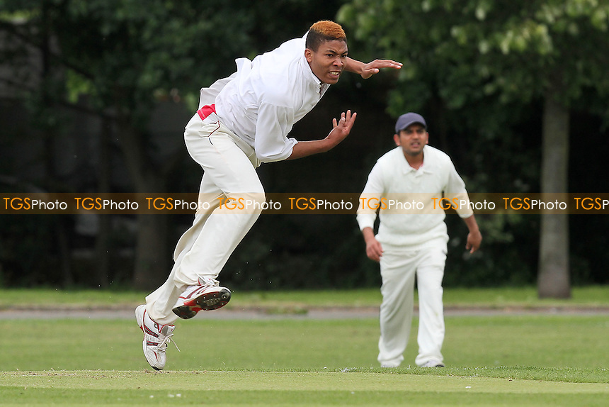 Q Daniels in bowling action for Hawks - Hornchurch Athletic CC vs Hawks CC - Essex Cricket League at Hylands Park - 23/06/12 - MANDATORY CREDIT: Gavin Ellis/TGSPHOTO - Self billing applies where appropriate - 0845 094 6026 - contact@tgsphoto.co.uk - NO UNPAID USE.