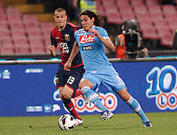 Edinson Cavani controls the ball as he is challenged by Genoa's     Luca Antonelli   during their Italian Serie A soccer match at the San Paolo  stadium in Naples April 7, 2013