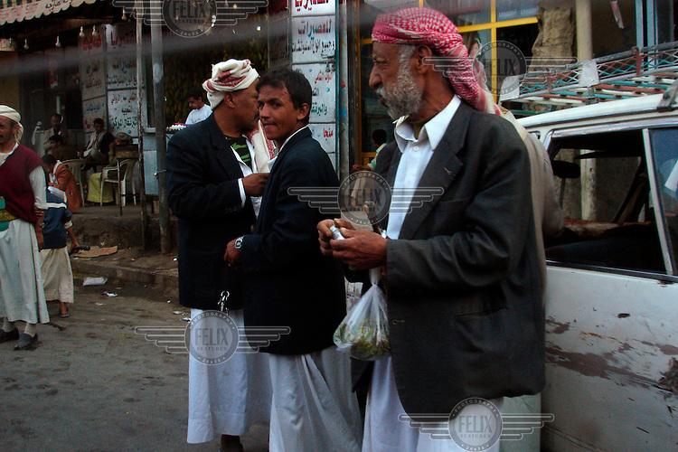 Men buy qat, a mildly hallucinogenic plant that is very popular in Yemen.
