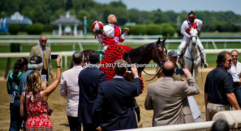 ELMONT, NY - JUNE 10: Mike Smith celebrates winning the the Ogden Phipps Stakes riding Songbird #5, on Belmont Stakes Day at Belmont Park on June 10, 2017 in Elmont, New York (Photo by Scott Serio/Eclipse Sportswire/Getty Images)