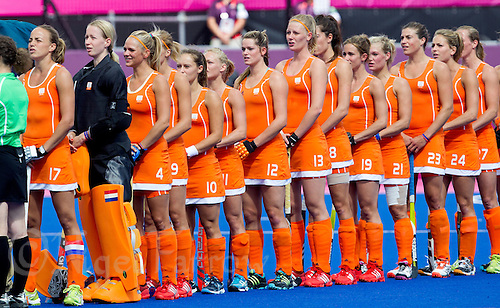 29 JUL 2012 - LONDON, GBR - The Netherlands (NED) team listen as their National Anthem is played before the start of their women's London 2012 Olympic Games Preliminary round hockey match against Belgium at the Riverbank Arena in the Olympic Park in Stratford, London, Great Britain (PHOTO (C) 2012 NIGEL FARROW)