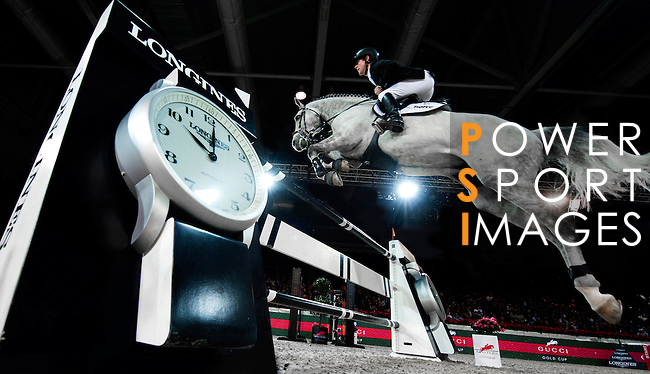 Marcus Ehning of Germany rides Cornado NRW at the Gucci Gold Cup during the Longines Hong Kong Masters International Show Jumping at Asia World Expo on March 1, 2013 in Hong Kong, Hong Kong. Photo by Manuel Queimadelos / The Power of Sport Images