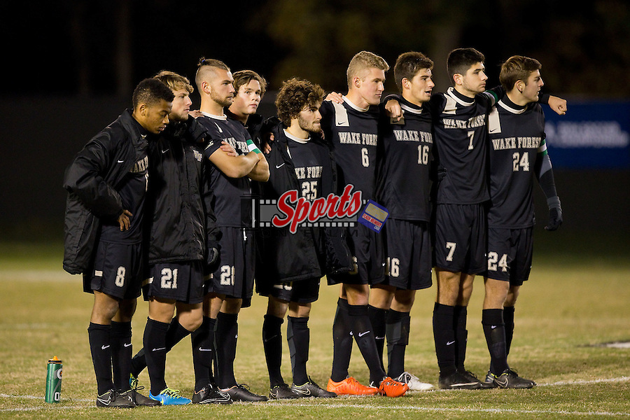 The Wake Forest Demon Deacons line up for the start of penalty kicks against the UMBC Retrievers at Spry Soccer Stadium on November 20, 2014 in Winston-Salem, North Carolina.  After battling to a 0-0 tie after two overtime periods, the Retrievers outlasted the Demon Deacons 3-2 in penalty kicks to advance to round two of the NCAA College Cup.  (Brian Westerholt/Sports On Film)