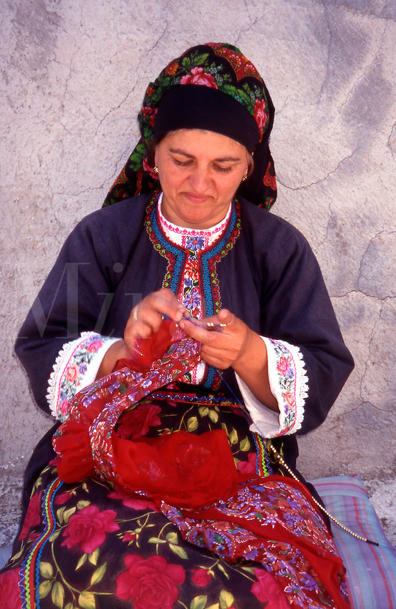Greece. Dodecanese Islands. Karpathos..A woman from Olympos Village doing Embroidery