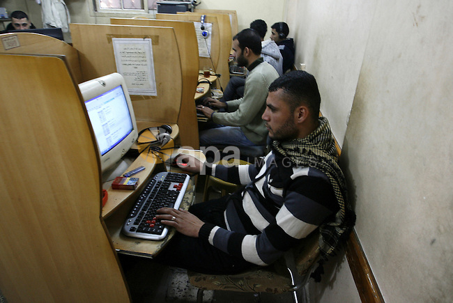"Palestinian man uses a computer as he looks at Visa cards on the web site in the southern Gaza Strip on January 18, 2012. The attacks were launched against Israeli sites at the beginning of this month when a Saudi internet expert called (0xomar) published details of thousands of Israeli credit cards and personal details of their holders. According to Israeli reports the pirates of the Internet who support the Palestinians were able to penetrate sites belonging to the Israeli banks. An Israeli expert in electronic security systems said that the pirate attacks suffered by the Israeli Web sites were smart, and half of the computers that were used were from within ""Israel"", while experts said the site had been attacking Israeliاpolice website. Photo by Abed Rahim Khatib"