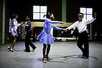 SOWETO, SOUTH AFRICA: Ballroom dancers rehearse in a community hall in Pimville Community center in Soweto, Johannesburg, South Africa. Ballroom dancing is very popular sport in the township and all over the country. Soweto is South Africa's largest township and it was founded about one hundred years to make housing available for black people south west of downtown Johannesburg. The estimated population is between 2-3 million. Many key events during the Apartheid struggle unfolded here, and the most known is the student uprisings in June 1976, where thousands of students took to the streets to protest after being forced to study the Afrikaans language at school. Soweto today is a mix of old housing and newly constructed townhouses. A new hungry black middle-class is growing steadily. Many residents work in Johannesburg, but the last years many shopping malls have been built, and people are starting to spend their money in Soweto.  (Photo by Per-Anders Pettersson)