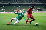 Nick Woltemade (werder Bremen #41)<br /> Edmond Tapsobsa (Leverkusen #12),  <br /> <br /> Sport: Fussball: 1. Bundesliga: Saison 19/20: <br /> 26. Spieltag: SV Werder Bremen vs Bayer 04 Leverkusen, 18.05.2020<br /> <br /> Foto ©  gumzmedia / Nordphoto / Andreas Gumz / POOL <br /> <br /> Nur für journalistische Zwecke! Only for editorial use!<br />  DFL regulations prohibit any use of photographs as image sequences and/or quasi-video.