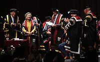 Pictured: Professor Richard B Davies (L), Vice Chancellor for Swansea University (L) and colleagues award Hillary Clinton hith an honorary degree at Swansea University Bay Campus. Saturday 14 October 2017<br />