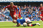 Madjid Bougherra hooks the ball away from Lee Miller