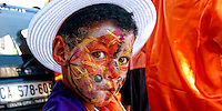 Young Boy preparing for traditional Noon Carnival, Cape Town, SA 2009