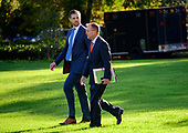 Eric Trump, left, and Acting White House Chief of Staff Mick Mulvaney, right, walk across the South Lawn to accompany United States President Donald J. Trump as he prepares to depart the White House in Washington, DC to deliver remarks at a Keep America Great Rally in Minneapolis, Minnesota on Thursday, October 10, 2019.<br /> Credit: Ron Sachs / CNP