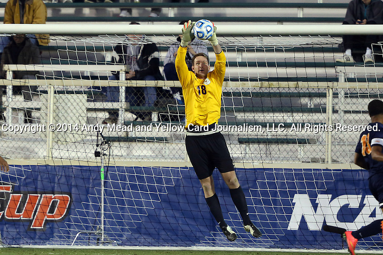 12 December 2014: Virginia's Calle Brown makes a save. The University of Virginia Cavaliers played the University of Maryland Baltimore County Retrievers at WakeMed Stadium in Cary, North Carolina in a 2014 NCAA Division I Men's College Cup semifinal match.