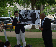 "May 24, 2011 (Washington, DC) Congressman John Lewis (D-GA) talked to a group of Texas students from the KIPP 3D Academy.  He showed the students large photographs of his activity in the civil rights struggle, and talked about knowing Dr. Martin Luther King, Jr.  ""Dr. King was a loving and compassionate man"" he told the students.  Lewis also talked about appearing on Oprah with the original ""Freedom Riders"", and said that ""things have changed from the times when white only signs were in the bus stationas"". (Photo: Don Baxter/Media Images International).."