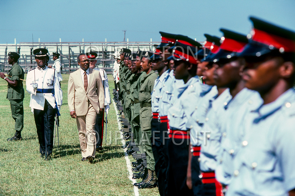 February 1987 --- Sir Paul Scoon, Governor of Grenada, reviews troops during the anniversary of Marines landing in Grenada, following a Communist plot in 1983. The operation, dubbed Operation Urgent Fury, was launched by President Ronald Reagan, and witnessed one of the largest deployment of troops since the Vietnam War. The war was swiftly concluded. | Location: Grenada. --- Image by © JP Laffont