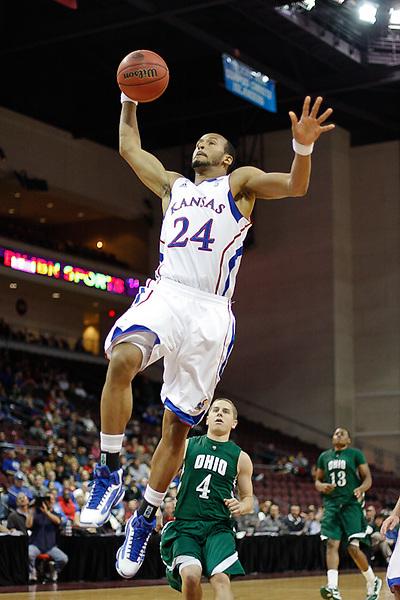 Nov. 26, 2010. Las Vegas, NV: The Kansas Jayhawks' Travis Releford dunks in the Las Vegas Invitational at the Orleans Arena.