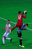 ARMENIA, COLOMBIA - JANUARY 19: Paraguay's goalkeeper Miguel Martinez jumps for the ball against Uruguay's Juan Ramirez during their CONMEBOL Pre-Olympic soccer game at Centenario Stadium on January 19, 2020 in Armenia, Colombia. (Photo by Daniel Munoz/VIEW press/Getty Images)