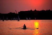 Sculling on the Charles River at sunset. Boston-Cambridge line, Massachusetts.