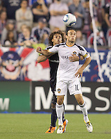 New England Revolution defender Kevin Alston (30) and Los Angeles Galaxy midfielder Landon Donovan (10) battle for head ball. In a Major League Soccer (MLS) match, the Los Angeles Galaxy defeated the New England Revolution, 1-0, at Gillette Stadium on May 28, 2011.