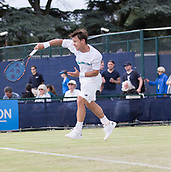 June 13th 2017, Nottingham, England; ATP Aegon Nottingham Open Tennis Tournament day 4; Ricardas Berankis of Lithuania takes to the air in his match against Tobias Kamke of Germany
