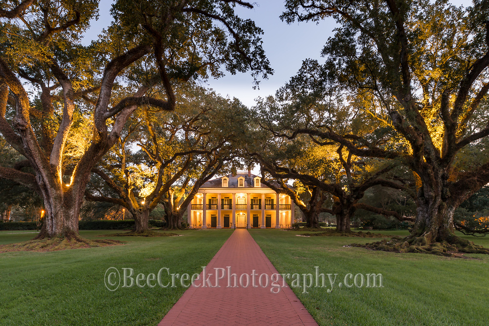 This errie image of the mansion as dusk is creeping toward night where you can see that some of the trees are lit along with the porch lights on the house give a errie glow yet beaufiful of evening at Oak Alley