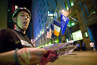 3 July 2005 - New York City, NY, USA - A rider checks his route map at an alleycat checkpoint on 43rd street in New York City, USA, July 3rd 2005. Alleycats are urban cycle races held informally - without notification of the authorities - on open roads and in real traffic, to simulate the messenger's working conditions. Photo Credit: David Brabyn<br />