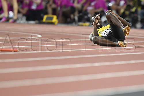 August 12th 2017, London Stadium, East London, England; IAAF World Championships, Day 9;  Jamaican athlete Usain Bolt lies on the racing track after suffering an injury while competing in the men's 4 x 100 metre relay race at the IAAF World Championships in London, United Kingdom, 12August 2017.