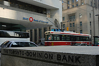 A tramway pass in front of THE TORONTO-DOMINION BANK, the NOVA SCOTIA BANK and the BANK OF MONTREAL on King Street West in downtown Toronto.<br />