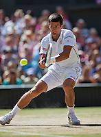 England, London, 28.06.2014. Tennis, Wimbledon, AELTC, Men's semifinal between Novak Djokovic  (SRB) and Grigor Dimitrov (BUL), Pictured: Novak Djokovic<br /> Photo: Tennisimages/Henk Koster