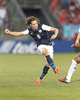 USMNT midfielder Mix Diskerud (8) passes the ball.  In CONCACAF Gold Cup Group Stage, the U.S. Men's National Team (USMNT) (blue/white) defeated Costa Rica (red/blue), 1-0, at Rentschler Field, East Hartford, CT on July 16, 2013.