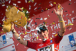 Elia Viviani (ITA) Team Sky takes over the race leader's Red Jersey on the podium at the end of Stage 2, The Capital Stage, of the 2015 Abu Dhabi Tour running 129 km from Yas Marina Circuit to Yas Mall, Abu Dhabi. 9th October 2015.<br /> Picture: ANSA/Claudio Peri | Newsfile