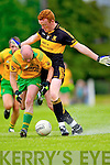Gneeveguilla's Mike B Murphy contests the ball with Johnny Buckley of Dr Crokes in Gneeveguilla last Sunday evening in round 1 of the Garvey's Supervalue County Senior Championship.