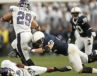 State College, PA - 11/06/2010:  Penn State LB Michael Mauti tackles Northwestern RB Mike Trumpy.  Mauti led the defense with 11 total tackles.  Despite trailing 21-0 in the first quarter, Penn State defeated Northwestern by a score of 35-21 at Beaver Stadium to give head coach Joe Paterno his 400th career victory...Photo:  Joe Rokita / JoeRokita.com..Photo ©2010 Joe Rokita Photography