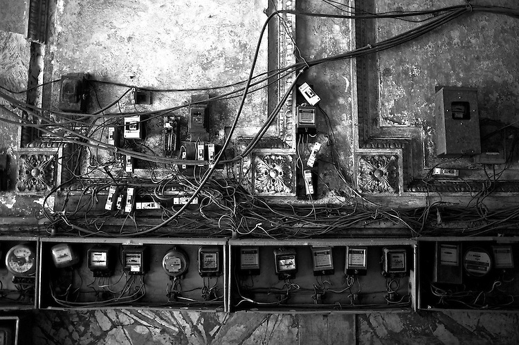 Images of Old Havana, Cuba. ..This, like many other apartment complex, have evolved to accomodate many families over the years, and in the process, the need for separate electricity bills has created a mess out of the unplanned electrical wiring.  A pretty common site in old Havana.