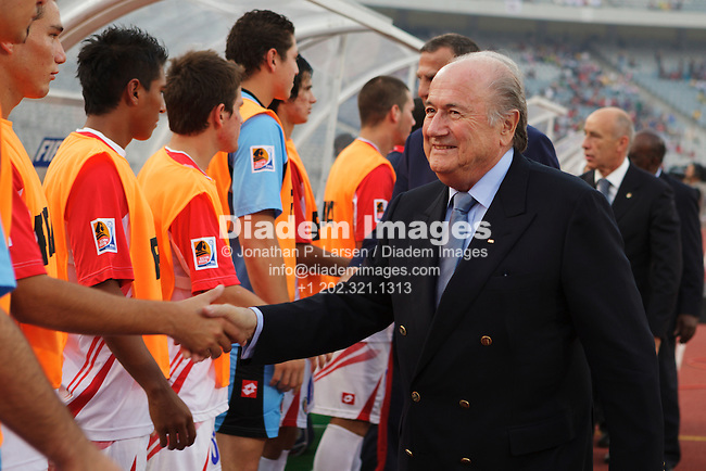 CAIRO - OCTOBER 16:  FIFA president Sepp Blatter greets Costa Rican players on the team bench before the 2009 FIFA U-20 World Cup third place match between Hungary and Costa Rica at Cairo International Stadium on October 16, 2009 in Cairo, Egypt.  Editorial use only.  No pushing to mobile device usage.  Commercial use prohibited.  (Photograph by Jonathan Paul Larsen)
