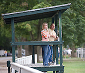 2009 leading Saratoga trainer Linda Rice watches the works.